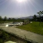 view of pool with vineyard and andes mountains in the background