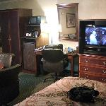 closet, microwave/fridge, desk and tv