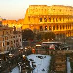 The Colosseum catching the sun on a snowy day, viewed from the roof terrace