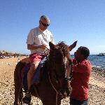 Paul receives instruction on horse riding at Happy Life Village, Dahab