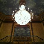 Gorgeous chandelier and painted ceiling!