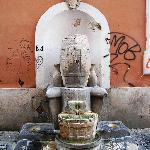 Nearby Cistern fountain with Roman grafitti
