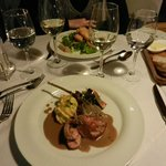 Brie cheese salad and Pheasant breast dish