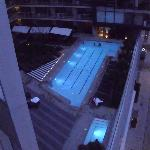 view of the pool and hot tub from our room at night