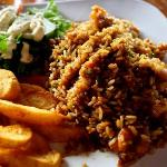 Shrimp and rice dish with tasty potato wedges