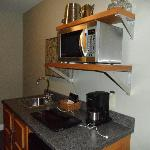 Bar fridge & sink, microwave, coffee pot