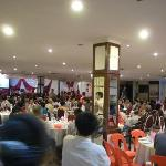 a view of the restaurant hosting a traditional wedding dinner