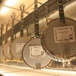 Hanging banjo display on second floor.