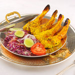 Tandoori Prawns - Jumbo prawns marinated in exotic Indian spices, finished in a charcoal oven