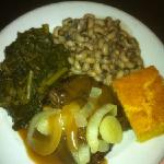 hamburger steak with mushroom onion gravy, fresh greens, and black eyed peas