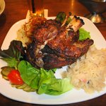 Schweinshaxn / Pork Knuckle. Crispy hind shank of grain fed pork served with potato salad, sauer