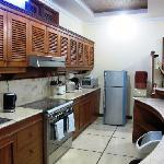 Fully equipped kitchen with fridge and cold water