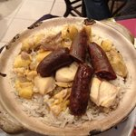 rice in clay port with sausage and chicken, must try!