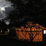 The yurt at night, lit from inside