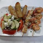 Kalamakia-marinated chicken and shrimp skewers