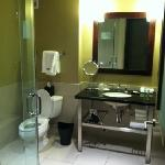 Bathroom has hair dryer, double head shower, separate bathtub and the best smelling soaps & sham