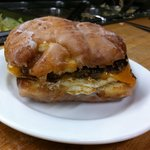 grilled apple fritter, homemade sausage pattie cheddar cheese and fried egg.