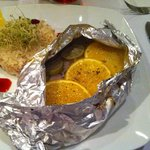 Perfectly moist fish in a foil packet with citrus.  Yummy