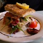 Focaccia sanwich of the day. Smoked salmon on a bed of salad green with there special dressing,