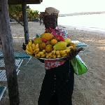 Mamma selling Babe her morning fruit, love the sugar bananas!
