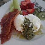 poached eggs over toast, pesto, proscuitto
