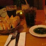 Bread with garlic pesto drizzled in olive oil