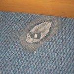 Hole in carpet