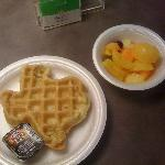 Texas shaped waffle and fresh fruit salad