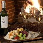 wine and cheese by the fire