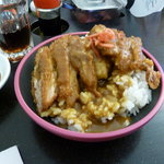 Chicken katsu with rice, a mild curry sauce and Japanese pickle.