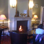 quaint lounge with a roaring fire..(soon to be renovated)