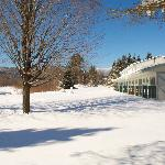 The Sun & Ski Inn and Suites West Wing and backyard during Winter time