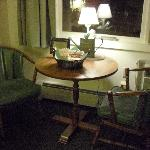 Table by the window with country lamp