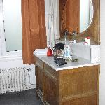 Antique in bathroom. Large mirror and room to hold toiletries etc