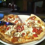 roasted goat pizza ...10 for flavor & quatity