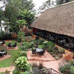 The garden and thatched roof dining room