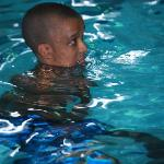 Alex swimming at night:) he love to!