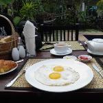 Enjoying breakfast by the poolside.