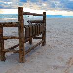 The famous bench on our white sand beach