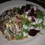 Seared NY Strip, its served with Beet and Arugula Salad, Pickled Onions, Blue Cheese, Mushrooms