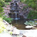 Cute waterfall near the front of the property as you pull in