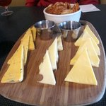 the cheese plate with Coswald, Emmental, and Dutch Gouda cheeses, with a side of pretzel chips,