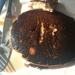 Terrible burnt pancakes after first lot were raw. Tried to hide it by putting burnt side face do