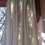 Filthy curtain on the balcony