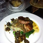squab with escargot on a bed of lentils