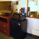 Flat screen tv, coffee, refrigerator, microwave