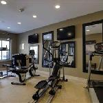All-new fitness center with total gym, treadmill, elliptical, & stationary bike
