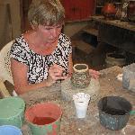 Merin painting her piece