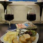 A real surprise, a tasty wine, cheese and olives snack with lovely organic wine