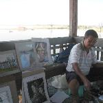 A local artist at work in the rest 'hut'